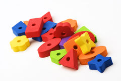 Multicolored toys 4. Multicolored toys in orange, blue, yellow, green, purple and red.  Different shapes. Isolated on white background Royalty Free Stock Image