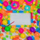 Multicolored toys blocks and bricks. Close up top view shot of multicolored toys, blocks, rings, interlocked lego, letters, wooden bricks, building game pieces stock photos
