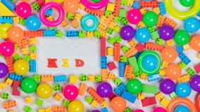 Multicolored toys blocks and bricks. Close up top view shot of multicolored toys, blocks, rings, interlocked lego, letters, wooden bricks, building game pieces royalty free stock photos