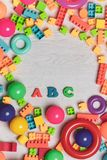Multicolored toys blocks and bricks. Top view shot of multicolored toys, blocks, rings, interlocked lego, letters, wooden bricks, building game pieces of kids stock images