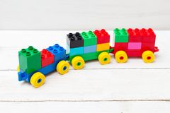 Multicolored train of colored plastic blocks. Early learning. Stock Photos