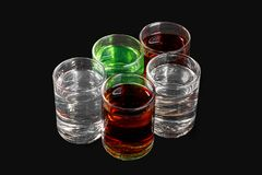 Summer cocktail on isolated black background. Multicolored transparent cocktails, a set of shots in a heap, a wedge, five servings. Side view from above Isolated Stock Photos