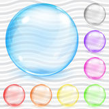 Multicolored transparent glass spheres. Set of multicolored transparent glass spheres with glares and shadows Royalty Free Stock Photo