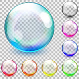 Multicolored transparent glass spheres. Set of multicolored transparent glass spheres on a plaid background Stock Images