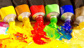Multicolored tubes of paint. Several colors on palette Stock Image