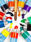 Multicolored tubes with squeezed watercolors Stock Images