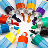 Multicolored tubes with squeezed watercolors Royalty Free Stock Photos