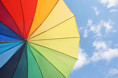 Multicolored umbrella against the sunny sky Royalty Free Stock Photos