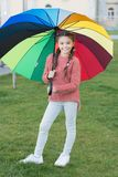 Multicolored umbrella for little happy girl. Positive mood in autumn rainy weather. Rainbow after rain. cheerful child. Spring style umbrella. Little girl hold royalty free stock photo
