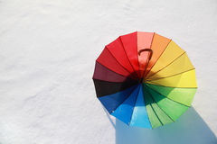 Multicolored umbrella lying on snow Royalty Free Stock Image