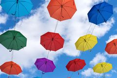 Multicolored umbrellas hanging high above the ground Royalty Free Stock Image