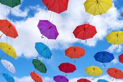 Multicolored umbrellas hanging high above the ground Royalty Free Stock Photo