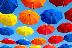 Multicolored umbrellas hanging over head on the street Royalty Free Stock Image