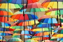 Multicolored umbrellas in the park Stock Photography