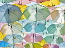 Multicolored umbrellas in pastel style. Royalty Free Stock Images