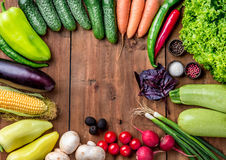 The multicolored vegetables on wooden table Stock Photo