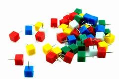 Multicolored vierkante spelden op witte achtergrond Stock Afbeeldingen