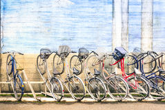 Multicolored vintage bicycles in metal rack in Tokyo city Royalty Free Stock Photo