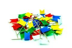 Multicolored vlagspelden op witte achtergrond Stock Afbeelding