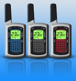 Multicolored walkie-talkies isolated on blue background Stock Photography