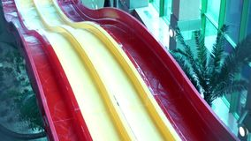 Multicolored water slides and pool in aqua park. Colorful water slides in the summer amusement park. Attractions in the aqua park. Multicolored water slides and stock video footage
