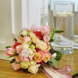 Multicolored wedding bouquet with silken ribbons Royalty Free Stock Images