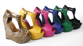 Multicolored wedges shoes. On a white background stock photography