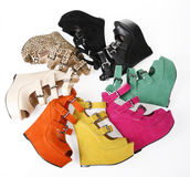 Multicolored wedges shoes in circle. On a white background royalty free stock image