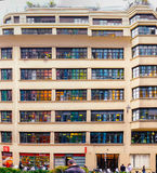 Multicolored windows on a building. Colored reflections from neighbour building. Paris, France Royalty Free Stock Image