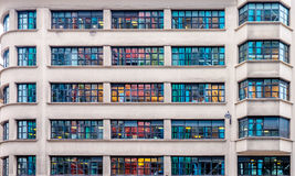 Multicolored windows on a building. Colored reflections from neighbour building. Paris, France Royalty Free Stock Photography