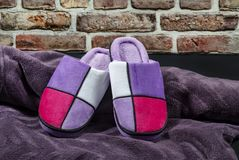Multicolored winter woman`s slippers stock photos