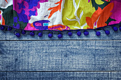 Multicolored womans skirt against blue wooden background Royalty Free Stock Image