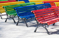 Multicolored wooden benches. red, green, yellow colors. difference conceptual image Royalty Free Stock Image