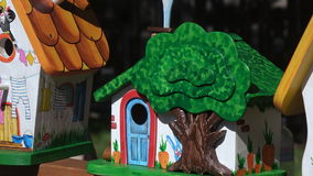 Multicolored wooden birdhouses stock video