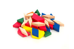 Multicolored wooden blocks.Macro.White wooden background.Isolate. Blocks; math; children; preschool; curriculum; building; montessori; program; on; tools Royalty Free Stock Photos