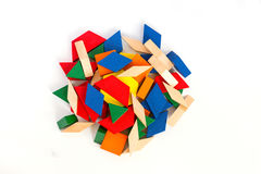 Multicolored wooden blocks. View from above. Macro.White wooden background.Isolate. Blocks; math; children; preschool; curriculum; building; montessori; program Royalty Free Stock Image
