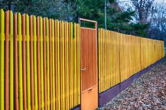 Multicolored Wooden Fence. In Serbia Stock Images