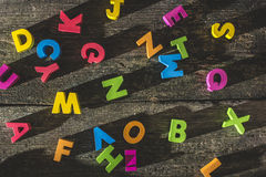 Multicolored wooden letters on vintage board Stock Photography