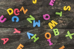 Multicolored wooden letters on vintage board Stock Images