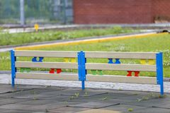 Multicolored wooden or plastic low decorative fence outdoors on sunny summer day.  royalty free stock images