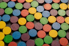 Multicolored, wooden, playing piece. Arranged in rows Royalty Free Stock Images