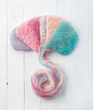 Multicolored woolen threads forming hat, topview Stock Photo