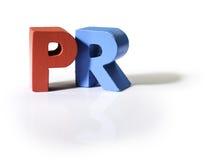 Multicolored woord PR van hout wordt gemaakt dat. Stock Afbeeldingen