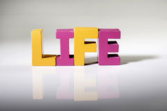 Multicolored word life made of wood. Stock Images