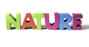 Multicolored word nature made of wood. Royalty Free Stock Photos