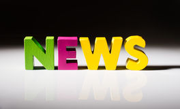 Multicolored word news made of wood. Royalty Free Stock Image