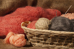 Free Multicolored Yarn Balls In A Straw Basket On The Sacking Stock Image - 43933041