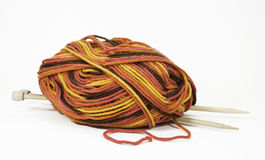 Multicolored Yarn and Wooden Needles Stock Photo