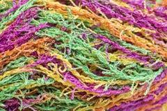 Multicolored Yarn. Wound skein of multicolored thread Stock Photos