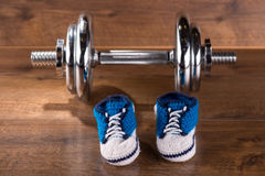 Multicolored youth gym shoes on floor Royalty Free Stock Photo